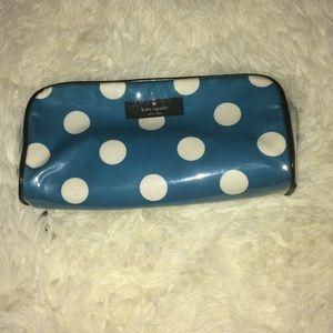 A Kate Spade cosmetic , makeup type bag